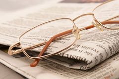 Press review. Glasses and newspapers. Press review Stock Photography