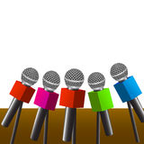 Press room microphones. News press room with microphones on blank background Royalty Free Stock Images
