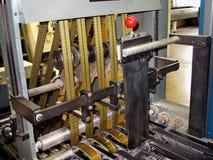 Press sheet cutter. Belts on press sheet cutter in publishing house royalty free stock photo
