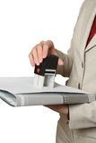 Press, stamp. Office worker seals on documents. A white background Stock Photo