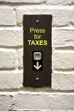 Press for taxes decrease text on elevator panel. Concrete wall Stock Images