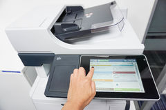 Press the touch screen for printing. And scanning documents Royalty Free Stock Images