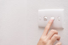 Press turn on/off electrical switch Stock Photo