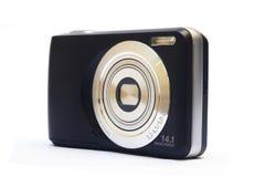 Pressa samman den digitala kameran Arkivfoto