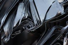 Pressande metallplattor Arkivfoto