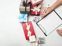 Presse-papiers de saison des vacances de présent de cadeau de liste de contrôle Image stock