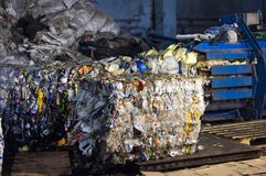 Pressed bale with garbage, press, waste sorting and processing, press. Pressed bale with garbage, press, waste sorting and processing, collection stock photography