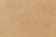 Pressed beige chipboard texture. Stock Image
