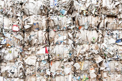 Pressed boxes made of paperboard prepared for recy. Pressed boxes made of paperboard carton  prepared for recycling Royalty Free Stock Photography