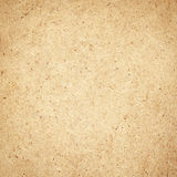 Pressed brown chipboard texture. Wooden background. Royalty Free Stock Photos
