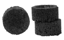 Pressed charcoal blocks isolated on white Stock Photos