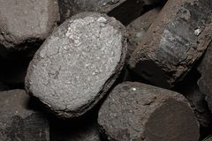 Pressed coal. Pressed brown coal - popular home fuel Royalty Free Stock Photo