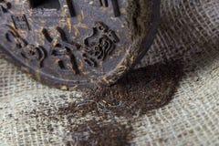 Pressed disc of tea with hieroglyphic. Pressed disc of tea with chinesse hieroglyphic Royalty Free Stock Photos