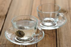 Pressed green puerh tea brewed in glass teacup Royalty Free Stock Images