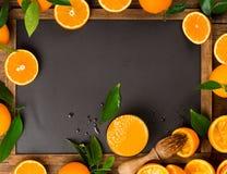 Pressed orange juice on blackboard Royalty Free Stock Photos