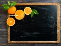 Pressed orange juice on blackboard Royalty Free Stock Images
