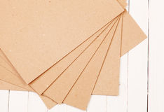 Pressed paper on wooden background. Pressed paper on a white wooden background Royalty Free Stock Photos