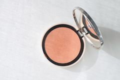 Pressed powder Blush Make up Beauty concept Decorative Cosmetics. White background Isolated Copy space Top view stock photo