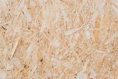 pressed sawdust in the board. Wooden textured background. background of pressed beige wooden sawdust royalty free stock image