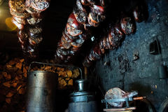Pressed smoked ham in smokehouse Royalty Free Stock Images