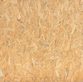 Pressed wooden panel background, seamless texture of oriented st Royalty Free Stock Photos