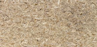 Pressed wooden panel seamless texture of oriented strand board - OSB. Pressed wooden panel background, seamless texture of oriented strand board - OSB royalty free stock images