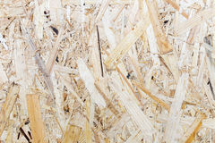 Pressed wooden panel background, seamless texture of oriented strand board - OSB wood Royalty Free Stock Photos
