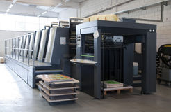 Pressedrucken - Offsetmaschine stockfotos