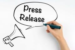 Pressemitteilung Megaphon und Text auf einem weißen Hintergrund Lizenzfreie Stockfotos