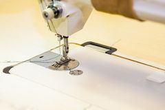 Presser foot sewing machines. Sewing machine in the workplace.Garment industry, designer atelier, tailoring process. Presser foot sewing machines. Sewing machine royalty free stock image