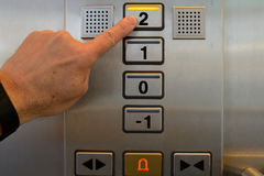 Presses elevator button Royalty Free Stock Images