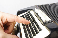 Pressing accordion buttons Stock Photography