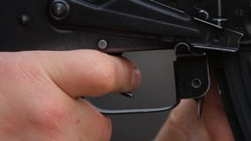 Pressing the assault rifle trigger. stock video
