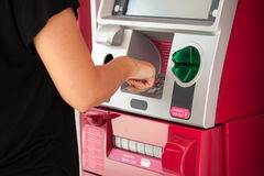 Pressing ATM machine Royalty Free Stock Photo