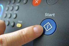 Pressing a blue start button royalty free stock image