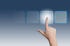 Pressing Button. Hand pressing a touchscreen button on blue-white background Stock Photo