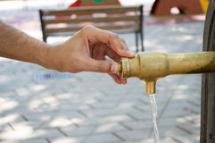 Pressing the button of the water fountain Stock Photography