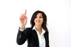 Pressing buttons on touchscreen. Business woman touching the screen with her finger isolated over a white background Stock Image