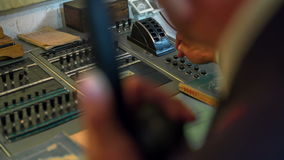 Pressing buttons on a vintage train control panel stock footage