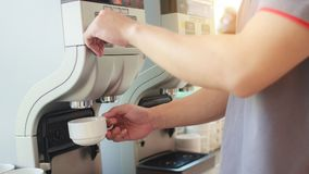 Pressing coffee from the coffee machine stock photo