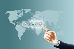 Pressing contact us button. Contact us concept, businessman pressing contact button on virtual screen Royalty Free Stock Photos