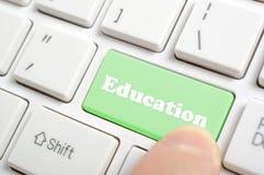 Pressing education key. Pressing green education key on keyboard Royalty Free Stock Photo
