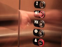 Pressing Elevator Button. Business woman pressing a button on the elevator Royalty Free Stock Photo