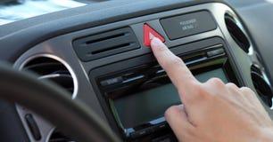 Pressing emergency warning lights button Stock Photo