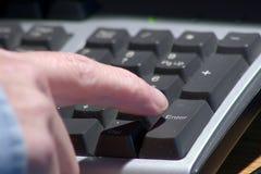 Pressing Enter. Right index finger pressing enter key on numeric keypad Stock Image