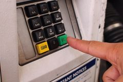 Pressing enter on a keypad Stock Photo