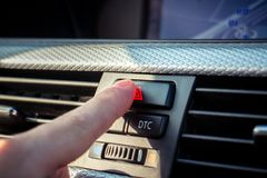 Car interior and details. Pressing the hazard button on modern car dashboard stock images