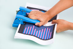 Pressing hole puncher Royalty Free Stock Images