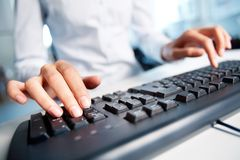 Pressing keys Royalty Free Stock Image