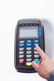 Pressing menu button on a credit card machine Royalty Free Stock Image